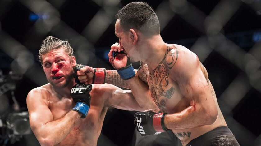 Max Holloway, right, fights Brian Ortega during the featherweight championship mixed martial arts bo