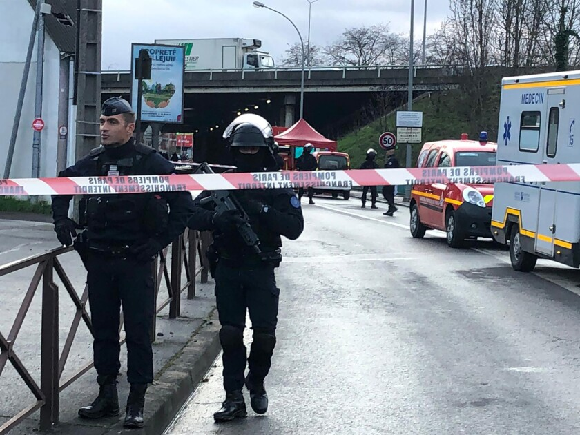 Police officers secure the area after a man attacked passerby Friday Jan.3, 2020 in Villejuif, south of Paris. A man armed with a knife attacked passers-by Friday in a southern Paris park, injuring some, before being shot by police, French officials said. (AP Photo/Oleg Cetinic