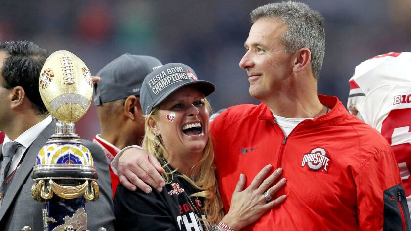 Ohio State coach Urban Meyer hugs his wife, Shelley, after their 44-28 win over Notre Dame in the Fiesta Bowl on Jan. 1, 2016.