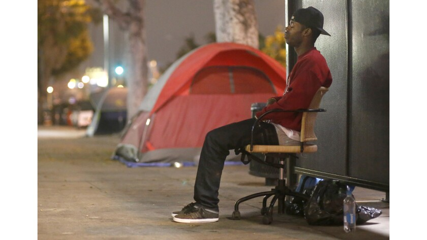 Diandre Pope, 31, stays in an encampment on Hollywood Boulevard.