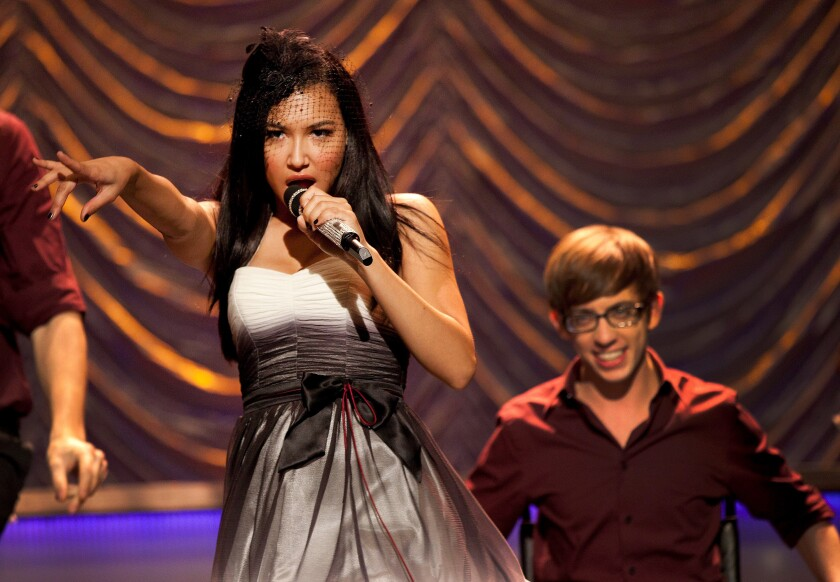 "Naya Rivera and Kevin McHale in ""Glee"""