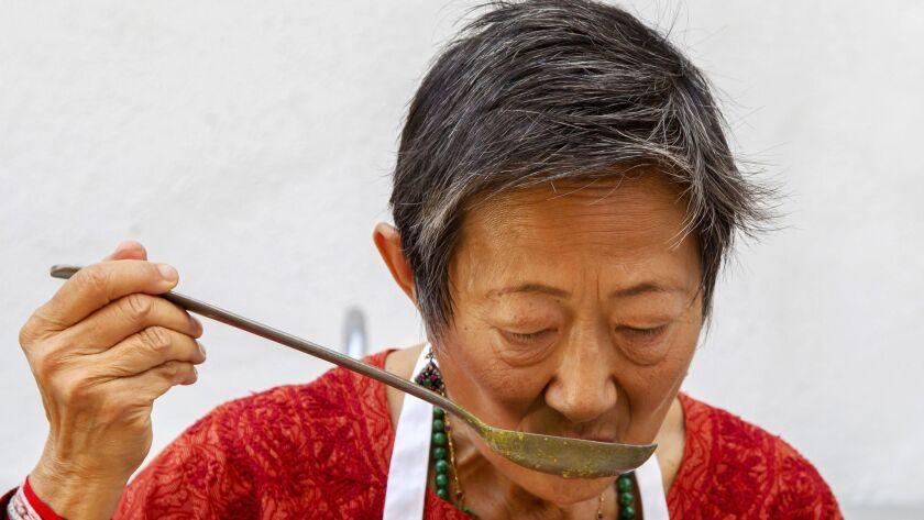 SAN DIEGO, CA-SEPTEMBER 10, 2015: | Su-Mei Yu tastes her Longevity Curry dish at her La Jolla home.