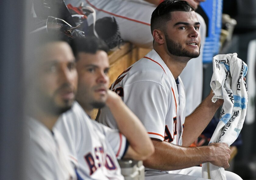 Houston Astros starting pitcher Lance McCullers, right, sits in the dugout after completing the third inning of a baseball game against the Oakland Athletics, Saturday, July 9, 2016, in Houston. (AP Photo/Eric Christian Smith)
