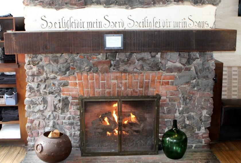 This fireplace, located in Eddie V's dining room, is the only intact architectural element left of the Green Dragon Colony today.