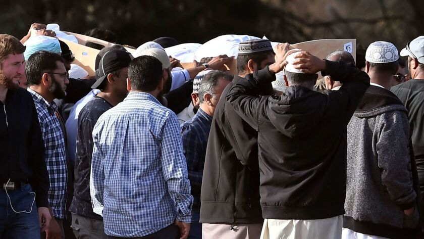 Mourners attend a funeral for victims of the mosque attacks at the Memorial Park cemetery in Christchurch, New Zealand, on March 20, 2019.