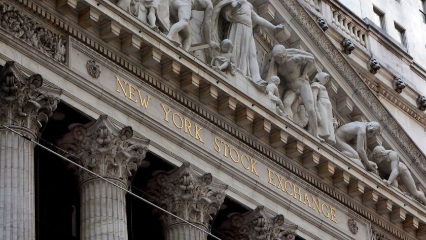 FILE- This April 5, 2018, file photo shows the facade of the New York Stock Exchange. The U.S. stock