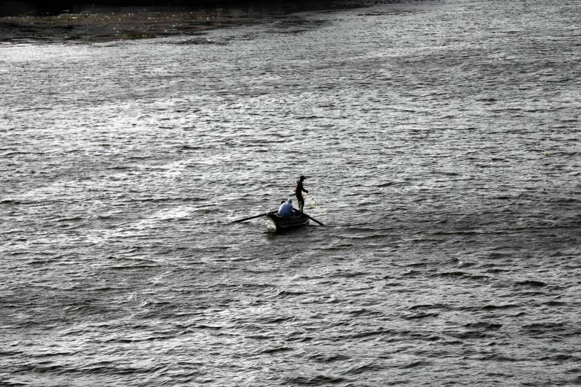 """A fisherman casts a net in the Nile in Cairo. In Ethiopia, where a dam project has sparked tensions with Egypt, the minister for water resources, Alemayehu Tegenu, said, """"We do not have any plan to harm downstream countries."""""""