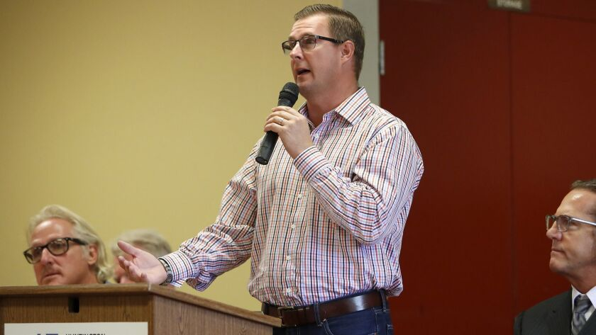 Ron Sterud speaks during a candidate forum at Murdy Park Recreational Center in Huntington Beach on