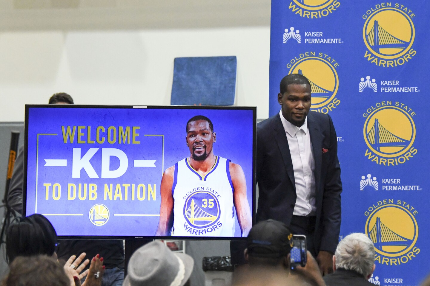 Jul 7, 2016; Oakland, CA, USA; Kevin Durant walks onto the stage during a press conference after signing with the Golden State Warriors at the Warriors Practice Facility. Mandatory Credit: Kyle Terada-USA TODAY Sports ** Usable by SD ONLY **