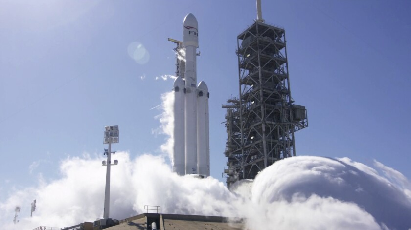 A SpaceX Falcon Heavy rocket is test fired at Cape Canaveral, Fla., on Jan. 24.