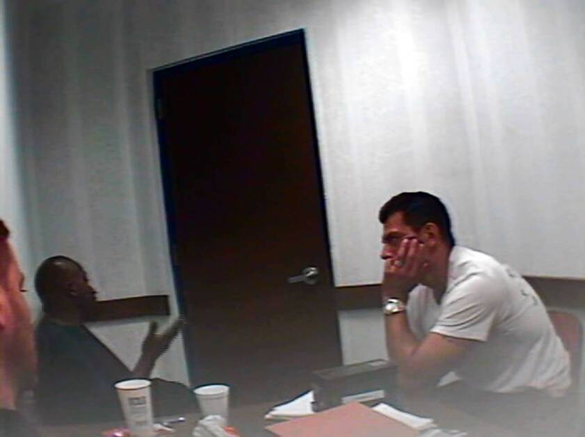 Anthony Brown, center, in a 2009 videotaped interrogation with LAPD, was a key informant in the FBIs investigation into L.A. County jails.