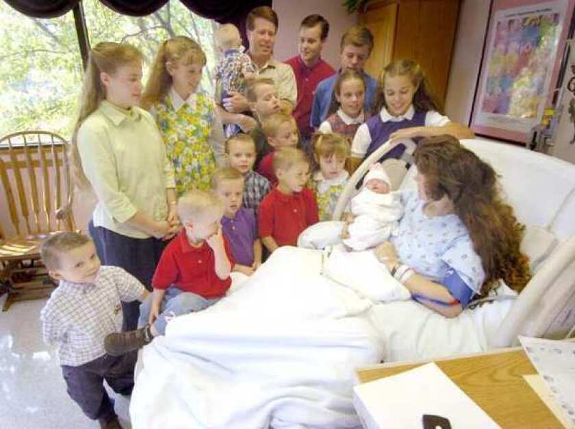 The Duggars in 2005, before they continued adding to their big family. The cost of raising a child born last year will be $234,900 until age 17.