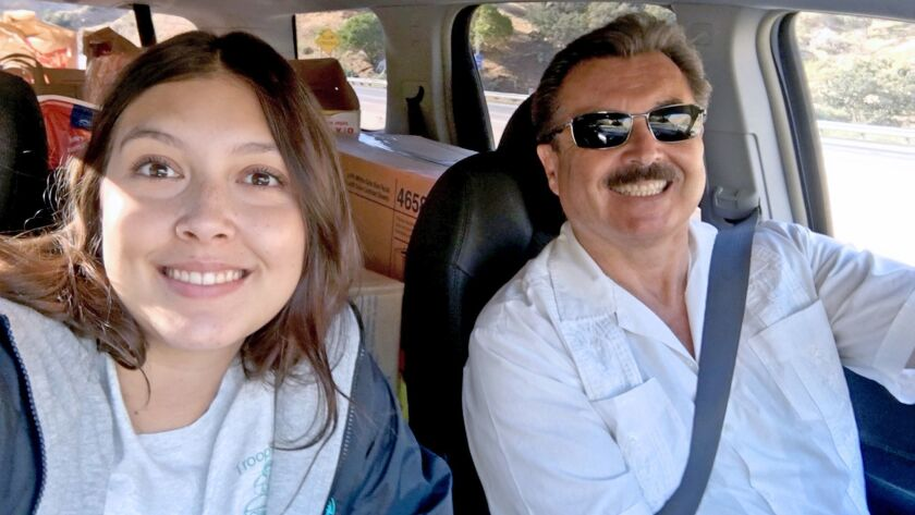 Girl Scout Julia Coronado-King takes a selfie with her father, Ernest King, as the prepare to deliver donations to farm workers.