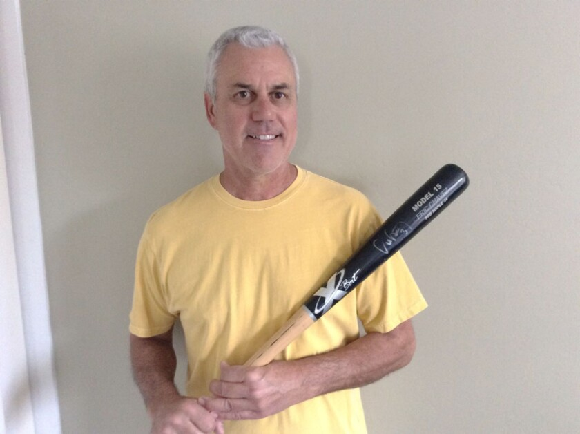 Jerry Haynal of Leucadia holds the autographed bat he received from Oakland third baseman Eric Chzvez.