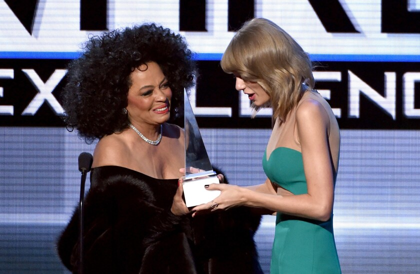 Diana Ross, left, presents the Dick Clark Award for Excellence to Taylor Swift.