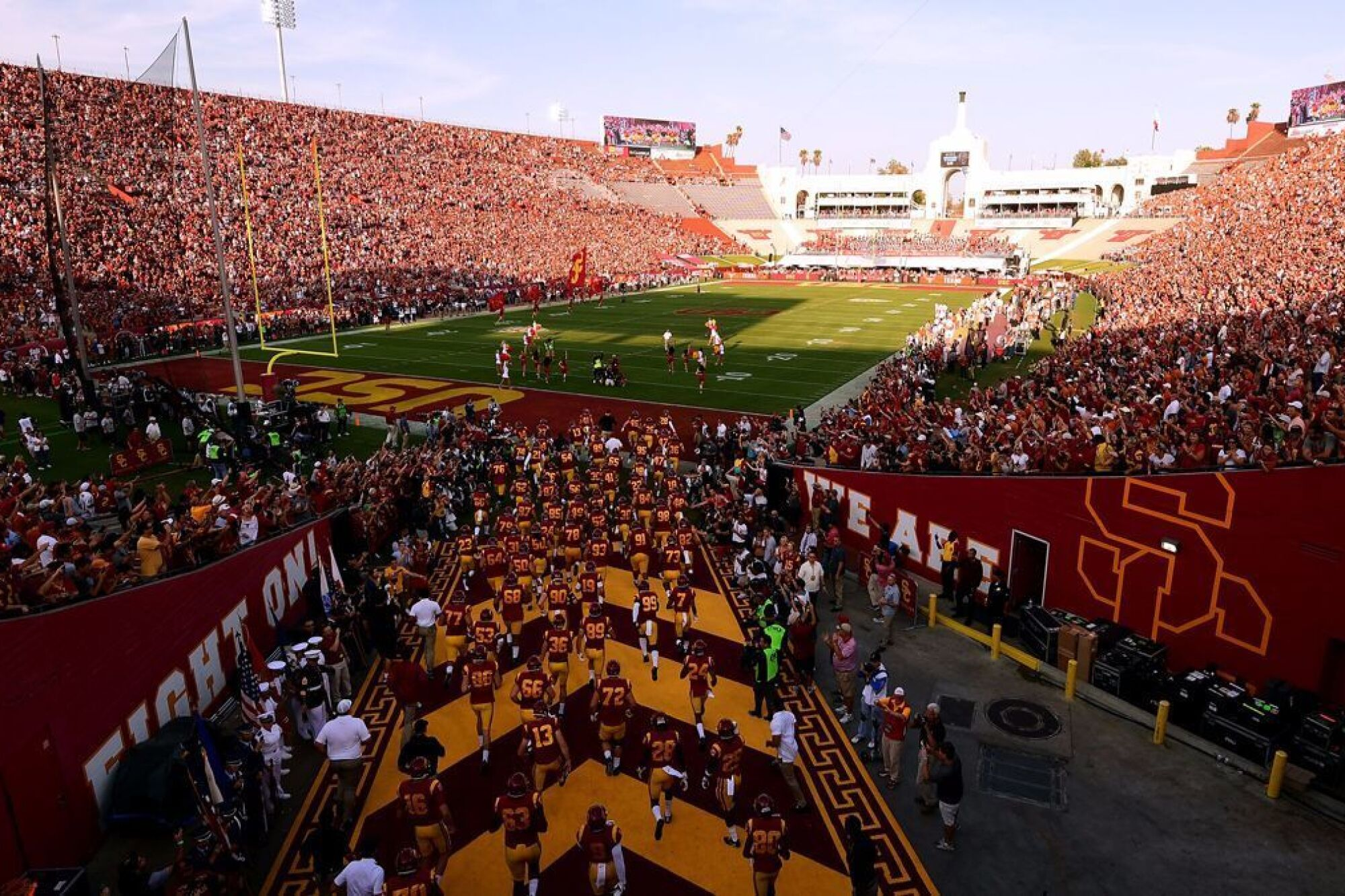 USC players take the field before a game against Fresno State.