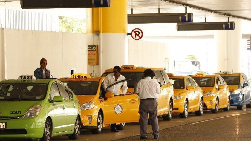 Taxis line up for fares at Los Angeles International Airport in 2016.