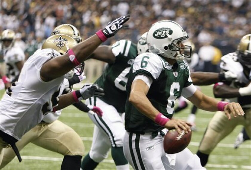 New Orleans Saints defensive end Will Smith (91) reaches for New York Jets quarterback Mark Sanchez (6) in the first half of an NFL football game in New Orleans, Sunday, Oct. 4, 2009. Smith caused a fumble and the Saints recovered for a touchdown. (AP Photo/Bill Haber)