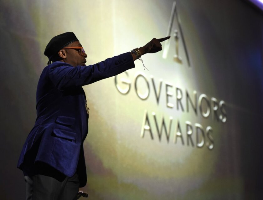 Spike Lee, honorary Oscar recipient, gestures onstage at the Governors Awards.