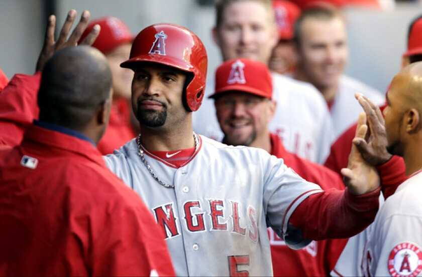 Angels first baseman Albert Pujols celebrates with teammates after scoring against the Chicago White Sox during a game last season.