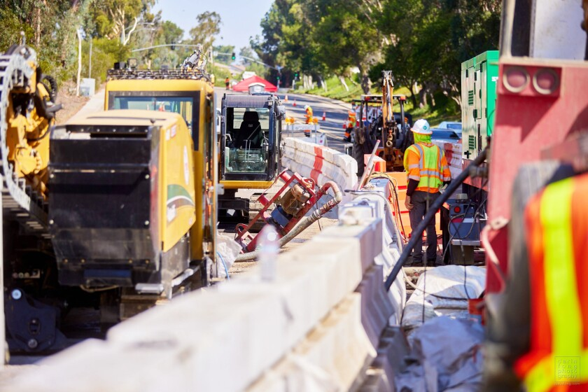 A crew working on the PSEP North Project at Pomerado and Oaks North roads in Rancho Bernardo on Monday.