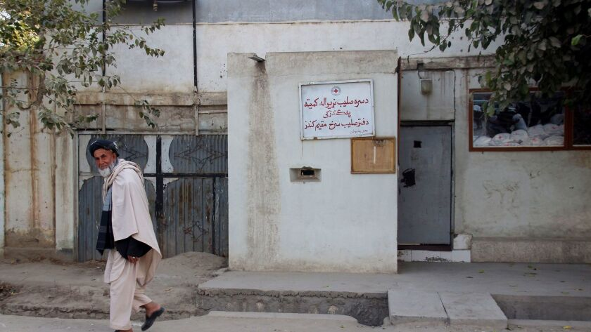 "A man walks in Afghanistan's Kunduz province in October. Local officials say at least 14 civilians have been killed by ""foreign airstrikes."" The U.S., which conducted an operation in Kunduz on Saturday, is investigating the reports."