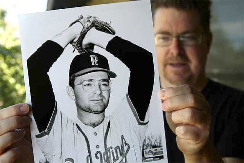 Baseball historian Terry Cannon holds a photo of Steve Dalkowski, a minor leaguer who is believed by some to have thrown the fastest pitch in history.