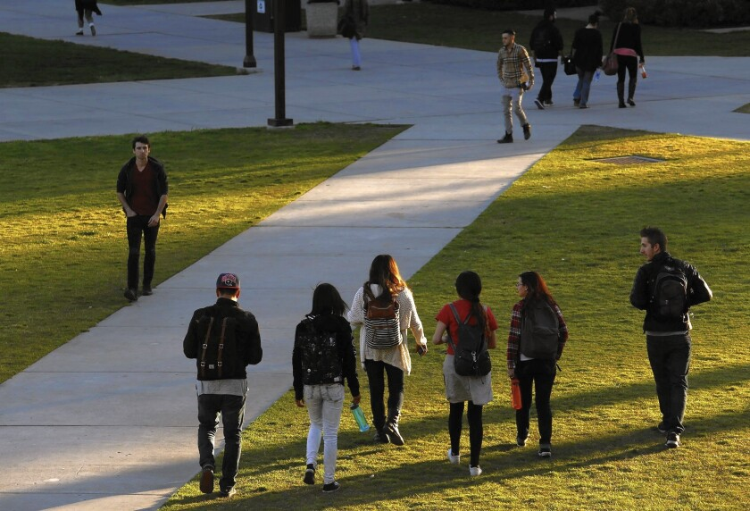 Groups of students make their way across the Cal State Northridge campus in 2015.