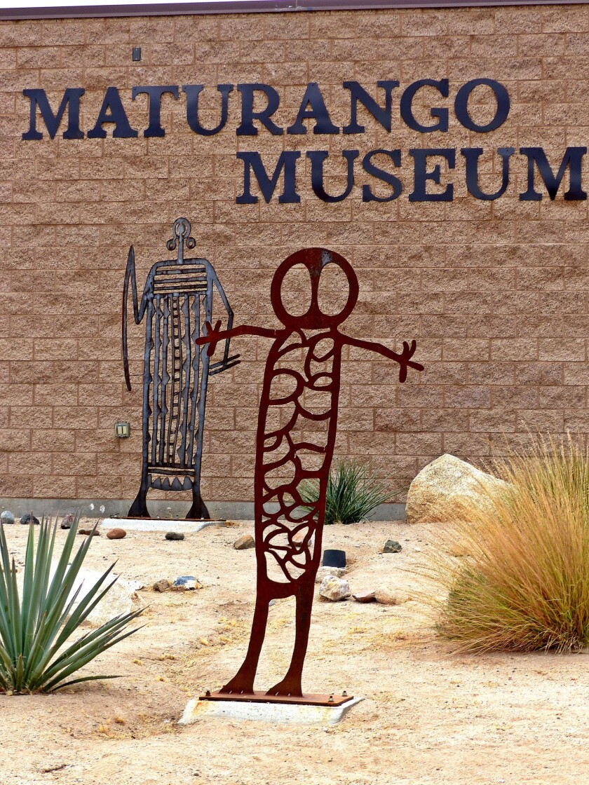 Stylized sculptures evoking ancient petroglyphs outside the Maturango Museum in Ridgecrest, Calif. The museum organizes annual tours to the petroglyph site.