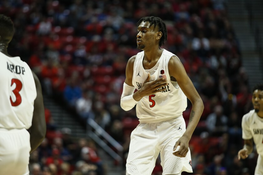 SAN DIEGO, February 16th, 2019 | San Diego State Aztecs vs. Boise State Broncos men's NCAA college basketball on Saturday, February 16th, 2019 at Viejas Arena in San Diego, CA. San Diego State forward Jalen McDaniels (5) reacts after making a basket in the first half against Boise State. Photo by Chadd Cady
