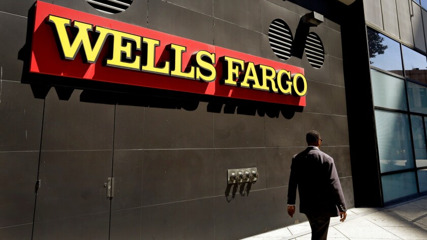 """A Wells Fargo office in Oakland. The bank's CEO says that aggressive sales tactics were not part of an """"orchestrated effort."""""""