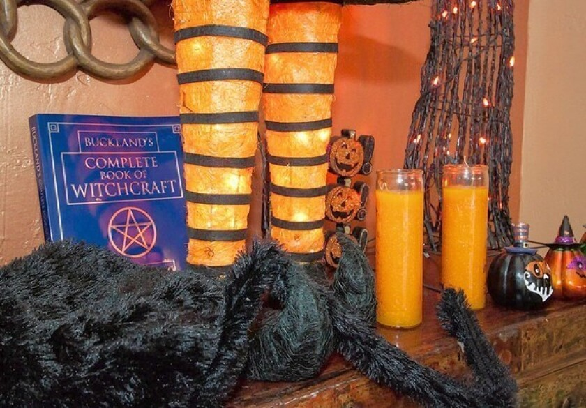 A witchcraft book is part of the Halloween display at the Chakra Shack, whose owner said the building used to be a mortuary and houses spirits.