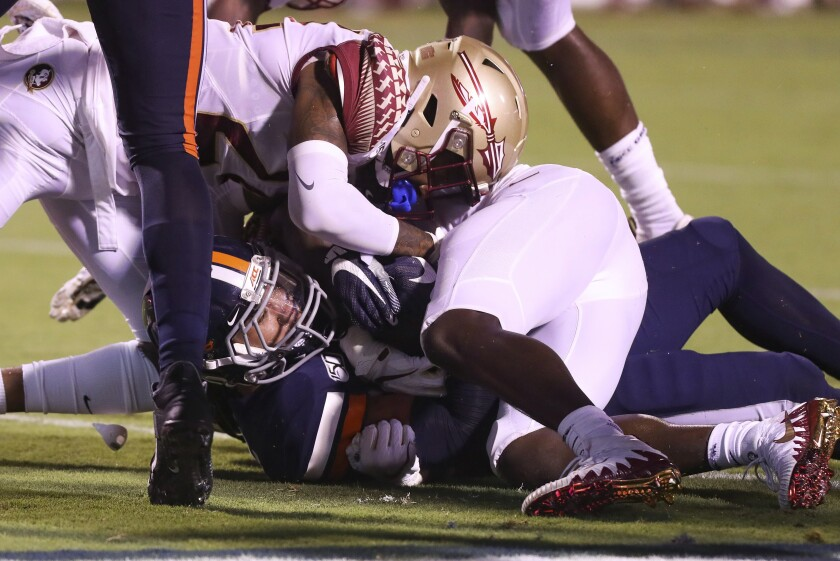 Virginia running back Wayne Taulapapa (21) scores a touchdown under Florida State defensive back Cyrus Fagan (24) during the first half of an NCAA college football game in Charlottesville, Va., Saturday, Sept. 14, 2019. (AP Photo/Andrew Shurtleff)
