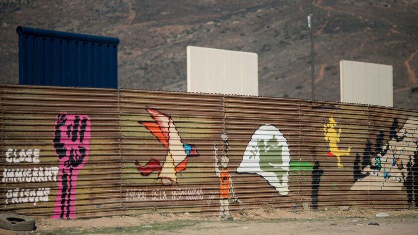 TIJUANA, B.C., MEX - FEBRUARY 01: Pro-immigration art is seen on the current border fence with the n