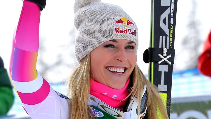 Lindsey Vonn celebrates after her record victory in a World Cup super-G race in Italy on Monday.