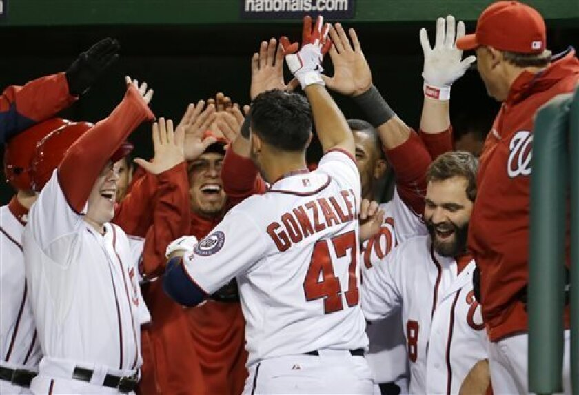Washington Nationals starting pitcher Gio Gonzalez (47) celebrates with his teammates after his solo home run during the fifth inning of a baseball game against the Miami Marlins at Nationals Park on Wednesday, April 3, 2013, in Washington. (AP Photo/Alex Brandon)