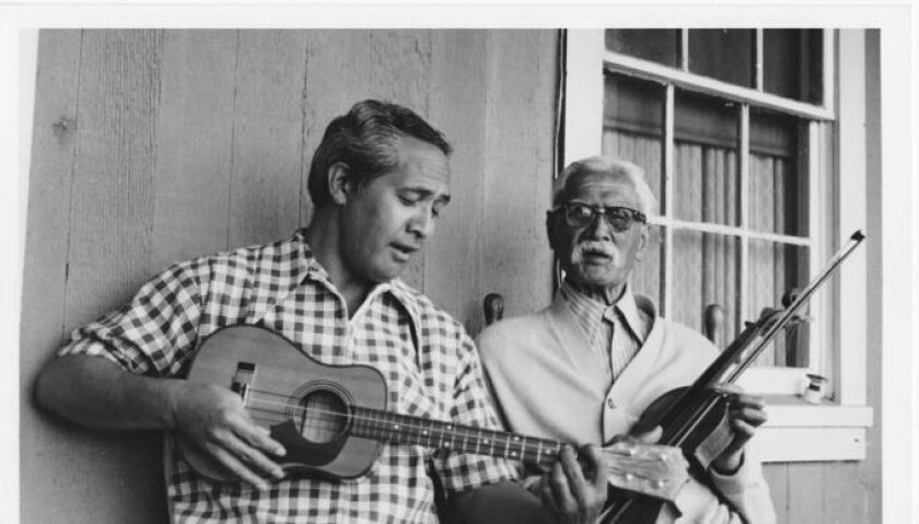 Eddie Kamae, left, and Hawaiian songwriter Sam Lia in a documentary film about Lia's life.