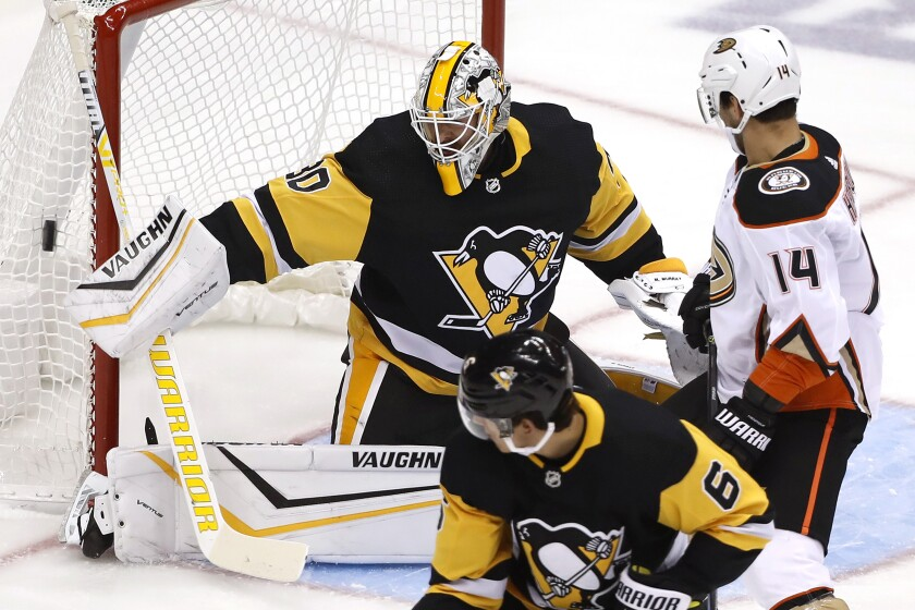 Pittsburgh Penguins goaltender Matt Murray (30) blocks a shot during the first period of the team's NHL hockey game against the Anaheim Ducks in Pittsburgh, Thursday, Oct. 10, 2019. (AP Photo/Gene J. Puskar)