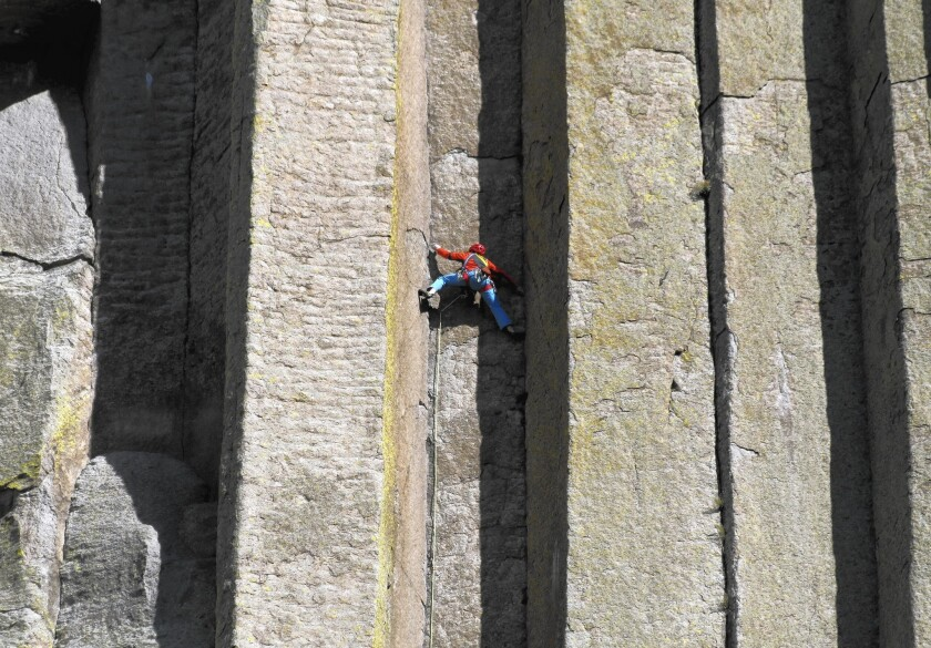 """Conrad Anker scales the columns of the Devils Tower National Monument in Wyoming in a scene from the breathtaking new """"National Parks Adventure."""""""