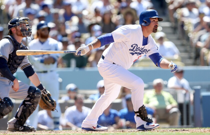 LOS ANGELES, CA - JULY 12: Adrian Gonzalez #23 of the Los Angeles Dodgers hits a two run home run in the eighth inning to give the Dodgers a 4-3 lead against the Milwaukee Brewers at Dodger Stadium on July 12, 2015 in Los Angeles, California. (Photo by Stephen Dunn/Getty Images) ** OUTS - ELSENT, FPG - OUTS * NM, PH, VA if sourced by CT, LA or MoD **