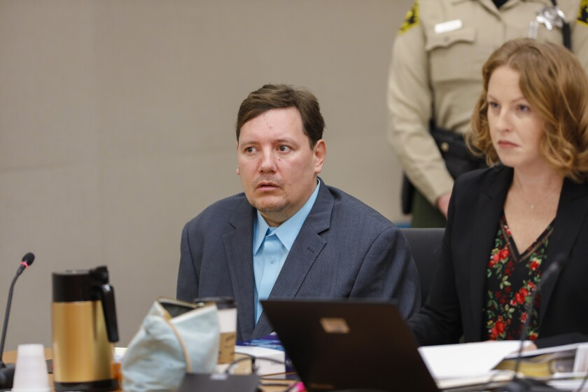 Jon Guerrero sits with his attorney Whitney Antrim during his preliminary hearing in Judge Kenneth So courtroom on Monday, November 4, 2019 in San Diego.