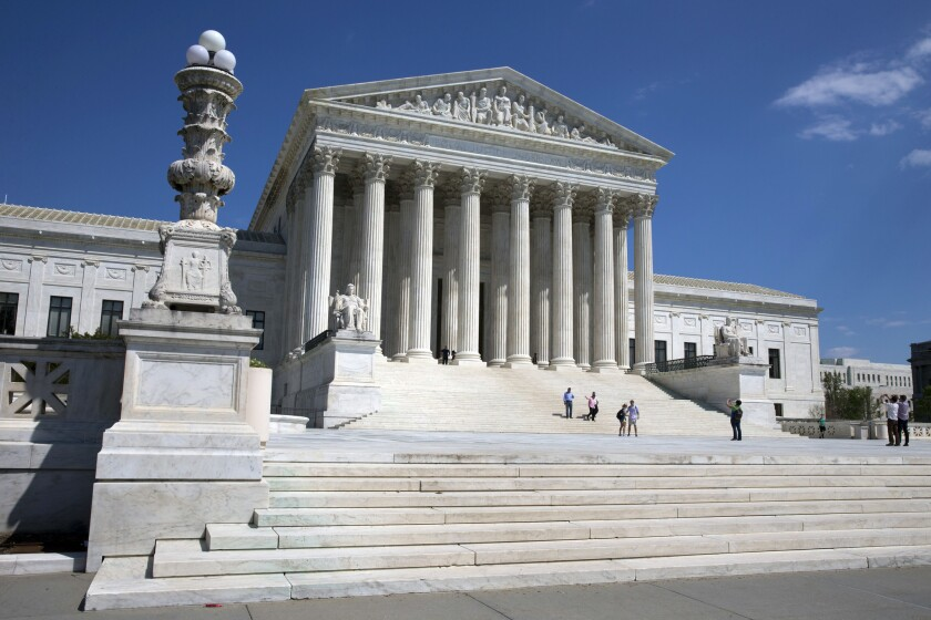 In this April 26, 2014 file photo, people walk on the steps of the U.S. Supreme Court in Washington.