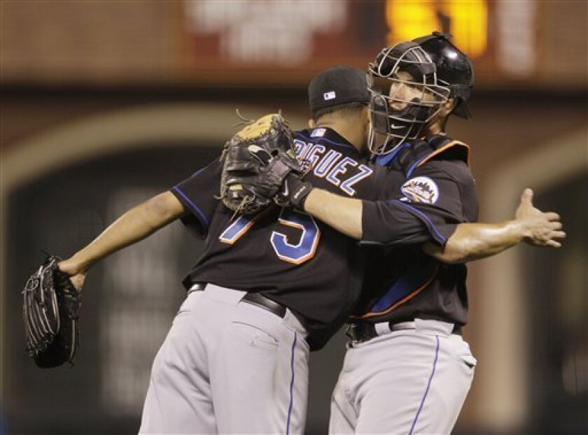New York Mets relief pitcher Francisco Rodriguez, left, is greeted by catcher Josh Thole, right, at the end of their baseball game against the San Francisco Giants in San Francisco, Friday, July 8, 2011. New York won the game 5-2. (AP Photo/Eric Risberg)