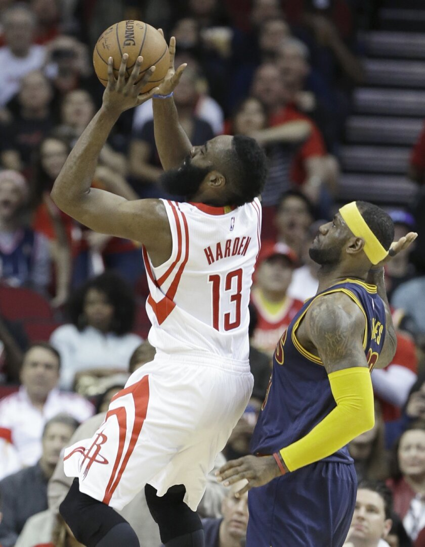 Houston Rockets' James Harden (13) shoots in front of Cleveland Cavaliers' LeBron James in the first half of an NBA basketball game, Sunday, March 1, 2015, in Houston. (AP Photo/Pat Sullivan)