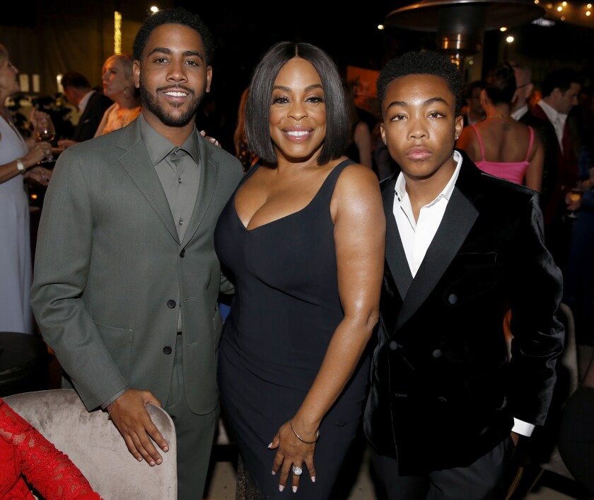 "Jharrel Jerome, from left, Niecy Nash and Asante Blackk, Emmy nominees from ""When They See Us,"" attend a Television Academy reception Sept. 20."