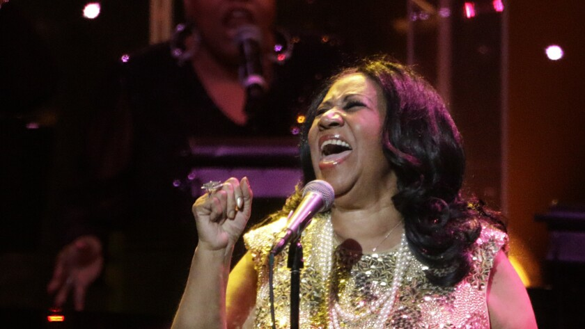 """Aretha Franklin, shown performing in Los Angeles in 2015, delivered what songwriter Paul Simon said is """"maybe the best cover of any of my songs that anyone ever did"""" with her rendition of """"Bridge Over Troubled Water."""""""