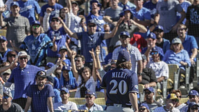 Brewers pitcher Wade Miley leaves the game after five pitches in the first inning.