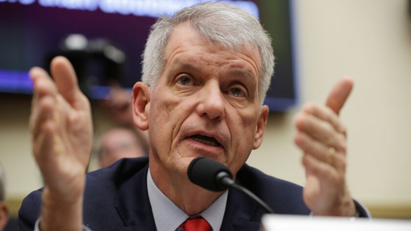 "Compensation for Wells Fargo CEO Timothy Sloan, shown testifying March 12 before Congress, includes a $2 million ""incentive award."""
