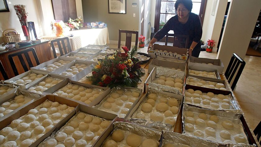 The Akiyoshi family table is covered with mochi, the traditional rice cakes that are a New Year's Day staple for many people of Japanese ancestry around the world. The Akiyoshis take the time to make the cakes by hand rather than simply purchasing them from specialty stores.