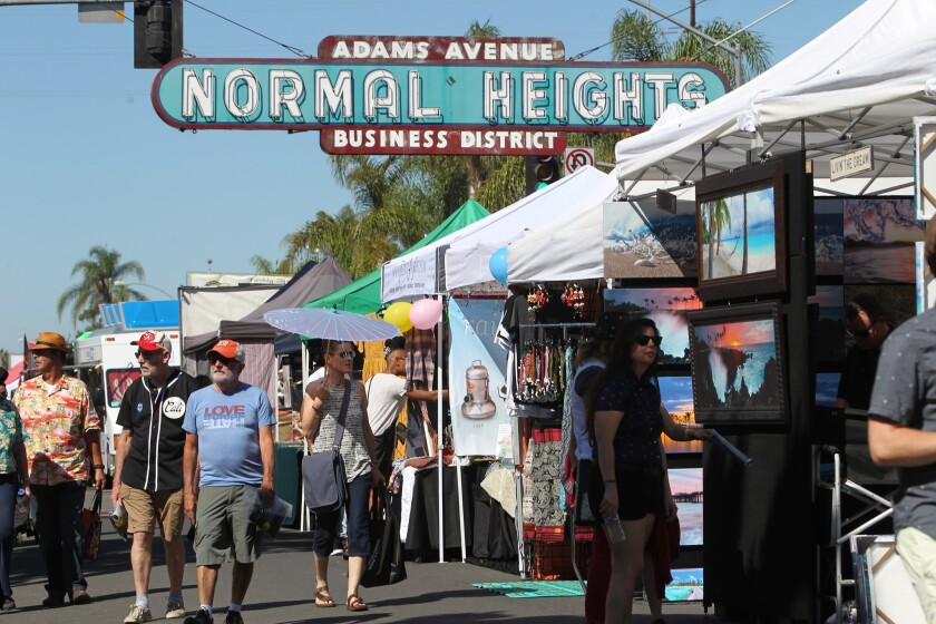 The Normal Heights sign beckons people to the annual Adam Avenue Street Fair, one of the largest free music festivals in San Diego.